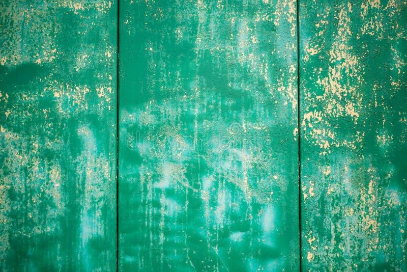 La struttura verde del fondo del mortaio, la parete verde, mortaio della crepa, fende il fondo della parete, struttura concreta immagine stock