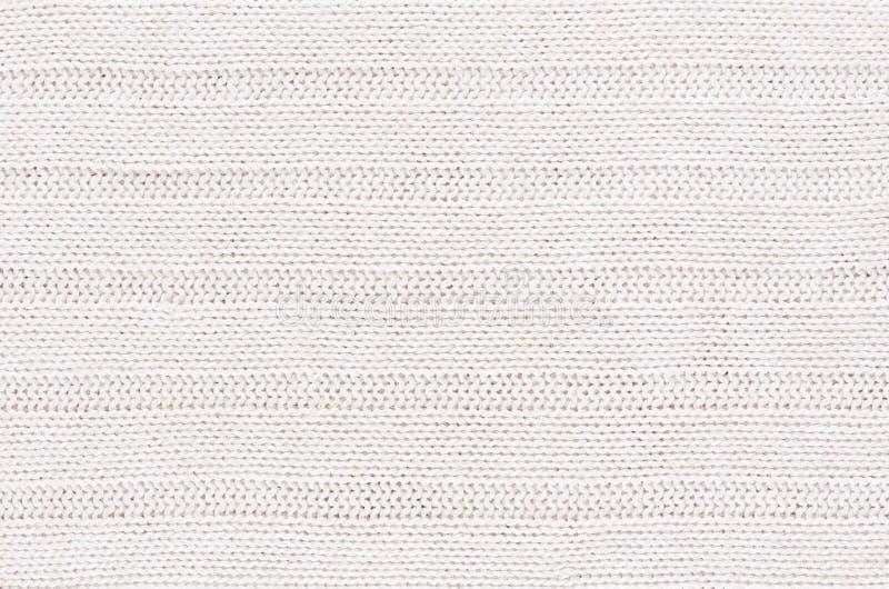La suavidad blanca hizo punto textura de la tela con el wale de las tiras foto de archivo libre de regalías