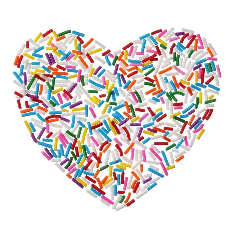 La sucrerie colorée arrose le coeur d'isolement sur le fond blanc photographie stock