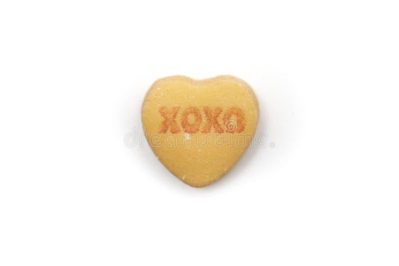 La sucrerie Xoxo d'amoureux étreint et des baisers image libre de droits