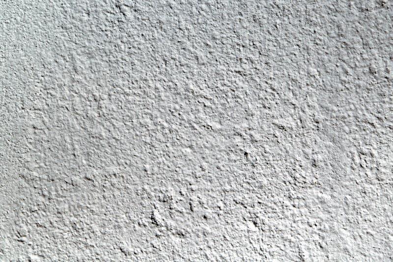 La superficie áspera del muro de cemento El yeso se pinta con la pintura gris fotos de archivo
