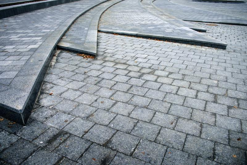 La superficie de la carretera de bloques de cemento imagen de archivo