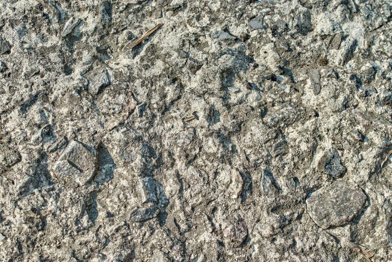 La superficie de piedra texturizada o el fondo gris imagen de archivo libre de regalías