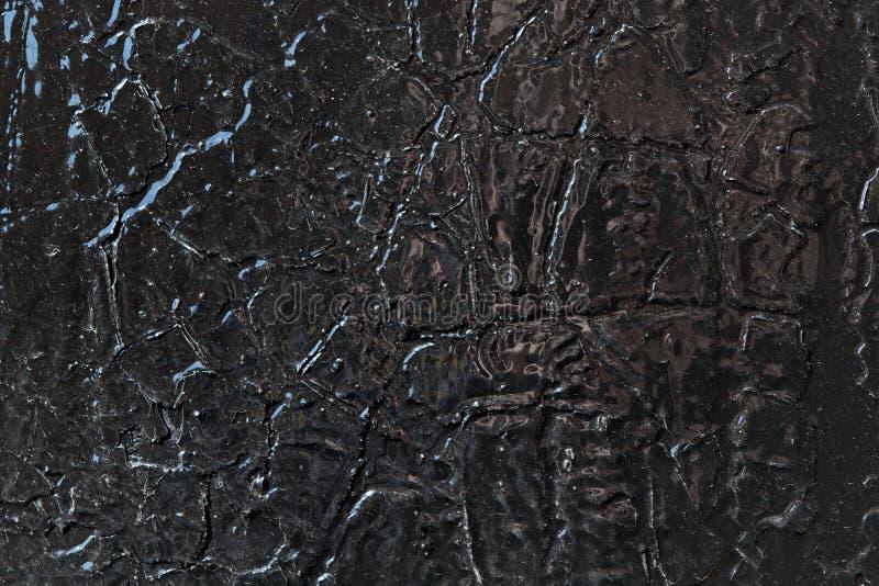 La superficie di metallo è dipinta con la pittura ad olio nera fotografie stock