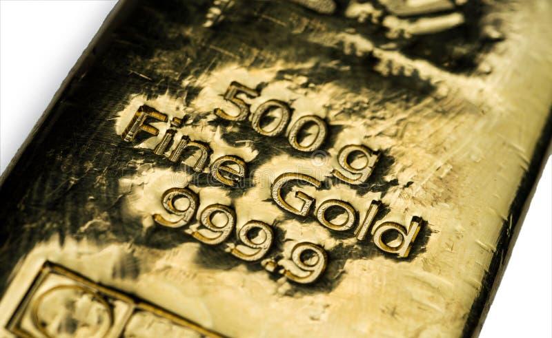 La surface du lingot d'or moulé La texture de la surface de la barre d'or image libre de droits