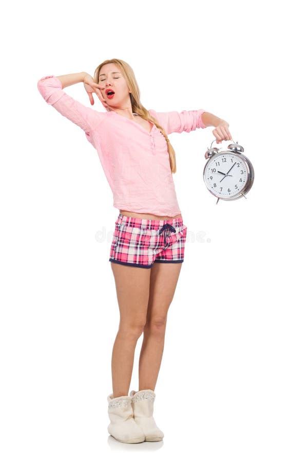 La sveglia di sbadiglio graziosa della tenuta della ragazza isolata su bianco fotografia stock libera da diritti