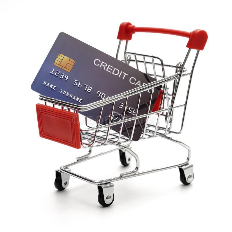 La tarjeta de crédito con el carro de la compra en el fondo blanco tiró en Studi fotografía de archivo libre de regalías