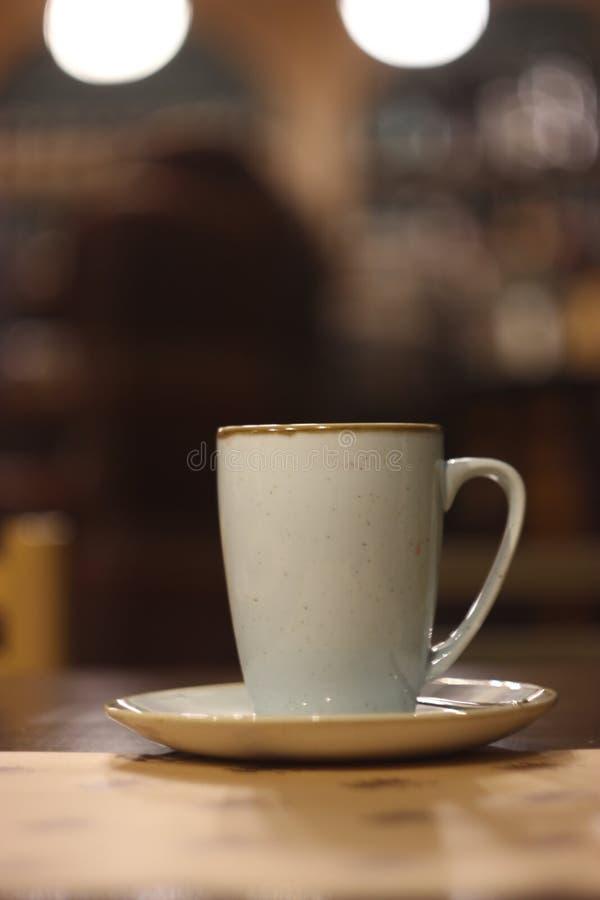 La tasse de la pièce en t photo stock