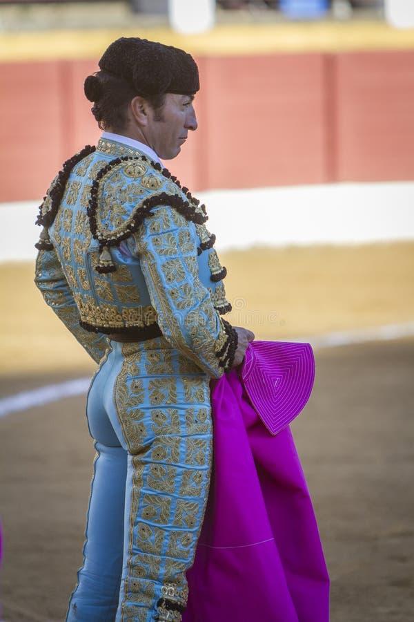 La tauromachie espagnole de fonds d'EL de toréador avec la béquille dedans photos libres de droits
