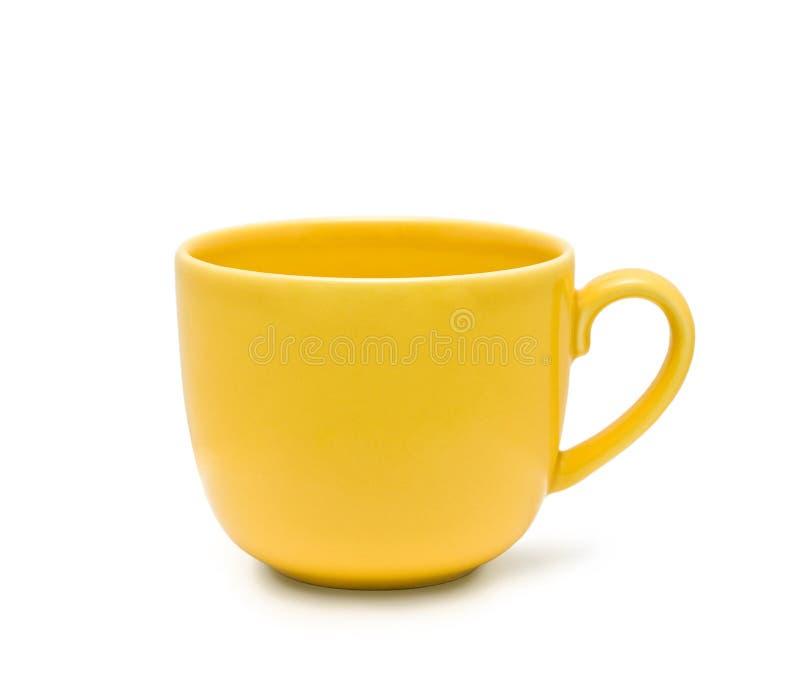 La taza amarilla fotos de archivo