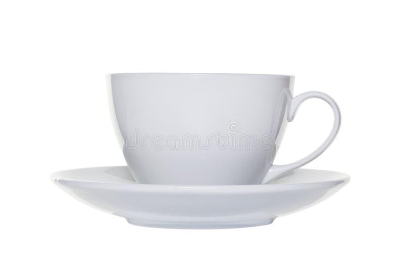 La tazza ed il piattino di tè bianchi hanno tagliato fotografia stock libera da diritti