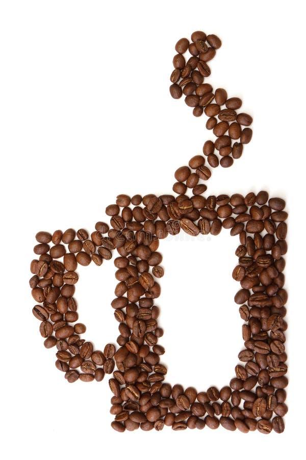 La tazza ha prodotto i chicchi di caffè del ââfrom fotografia stock libera da diritti