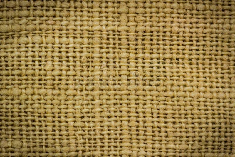 La tela di sacco, iuta-borsa ha strutturato il fondo. immagine stock