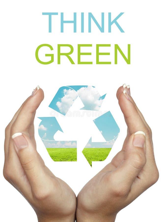 La tenuta della mano ricicla il segno di eco - pensi il concetto verde fotografia stock