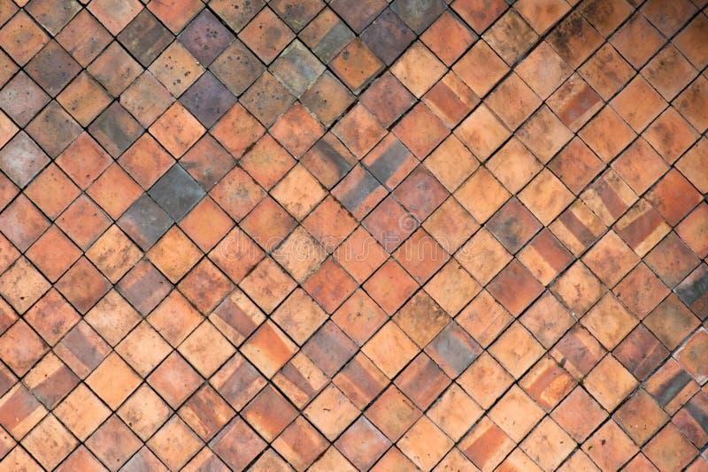La terracota teja la pared para el fondo abstracto de la textura stock de ilustración