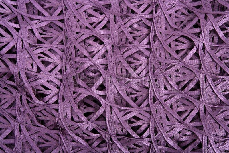 La textura atada con alambre púrpura de la tela tiene gusto de la red sucia de la araña imagen de archivo libre de regalías
