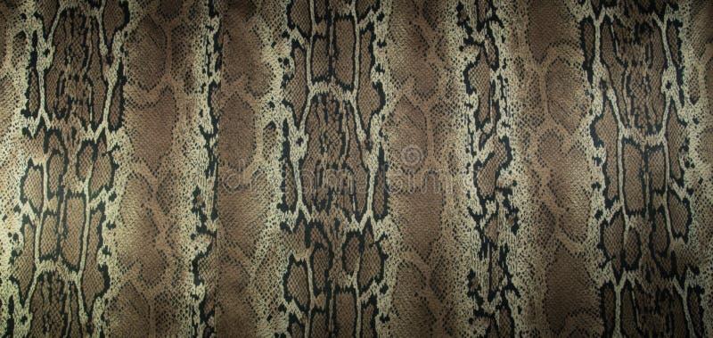 La textura de la tela de la impresión raya la serpiente para el fondo fotos de archivo