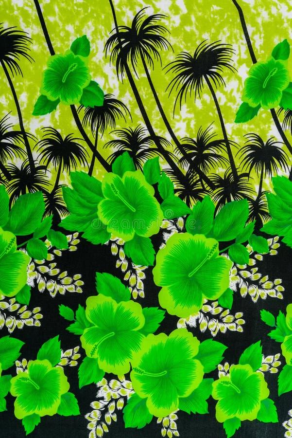 La textura de la tela de la impresión raya las flores naturales foto de archivo libre de regalías