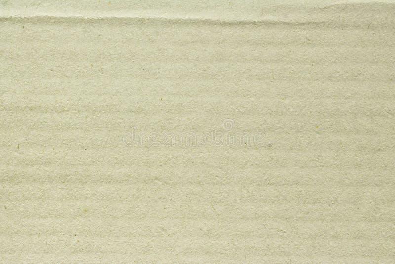 La textura de marrón claro rayado recicla el papel, fondo abstracto fotos de archivo