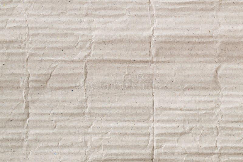 La textura de papel de la cartulina acanalada de Brown como fondo para la presentación, extracto recicla la textura de papel para foto de archivo