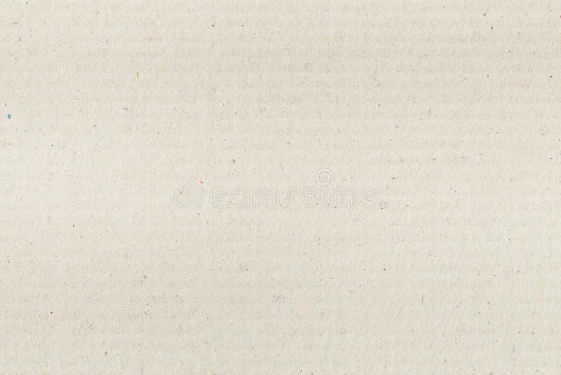 La textura de papel de la cartulina acanalada de Brown como fondo para la presentaci?n, extracto recicla la textura de papel para foto de archivo