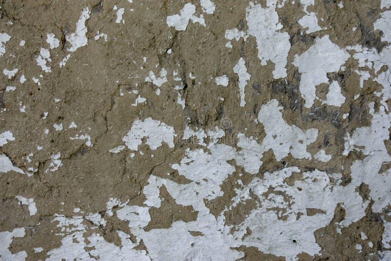 La textura de la pared vieja de la arcilla con la lechada de cal imagen de archivo