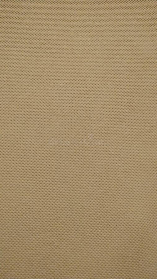 La textura de la tela sintética beige en una aproximación cercana Fondo Primer foto de archivo