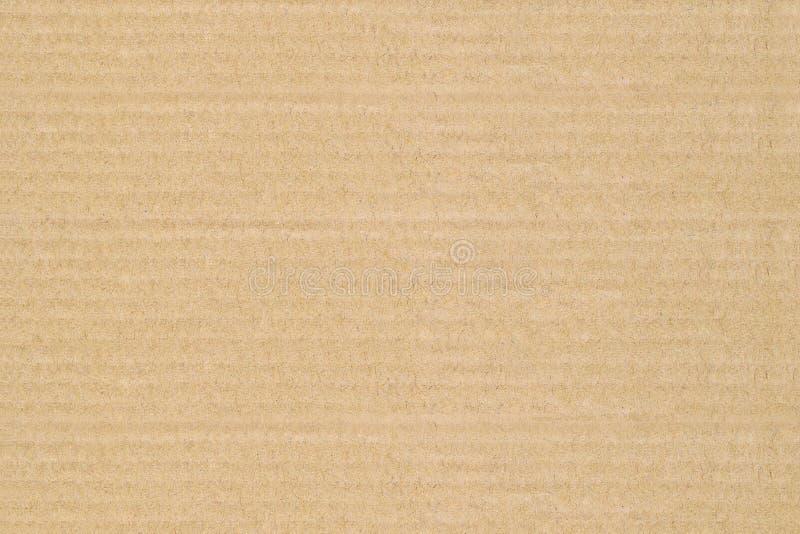 La textura del color marrón de las hojas de la cartulina tiene superficie áspera, fondo abstracto imagenes de archivo