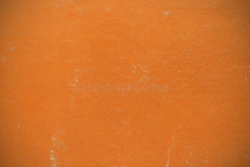 La textura del fondo se hace de la ilustración anaranjada de la cubierta de libro imagen de archivo