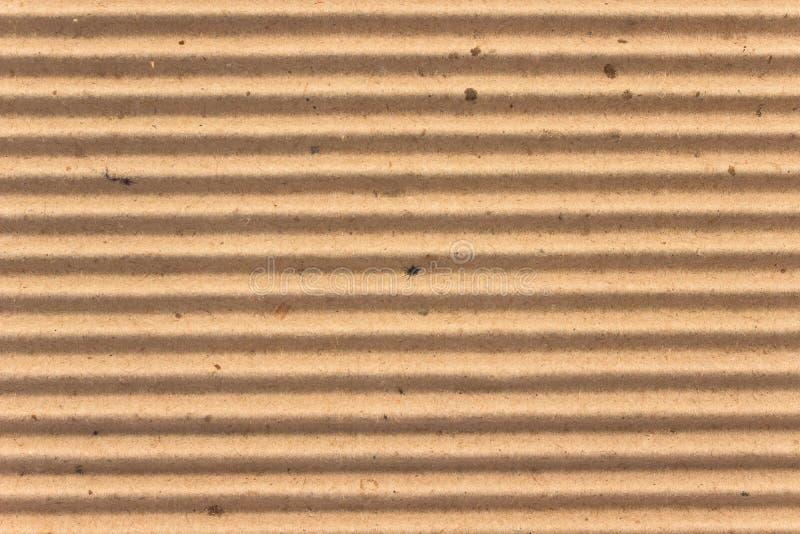 La textura del marrón acanala la cartulina como fondo fotografía de archivo libre de regalías