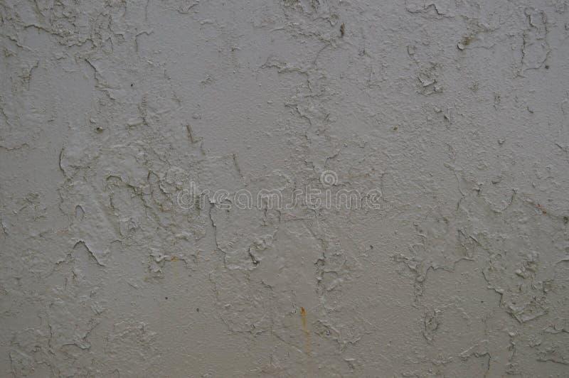 La textura del metal del hierro pintó la pintura de peladura gris de viejo estropeado rasguñado agrietó la pared oxidada antigua  fotos de archivo libres de regalías