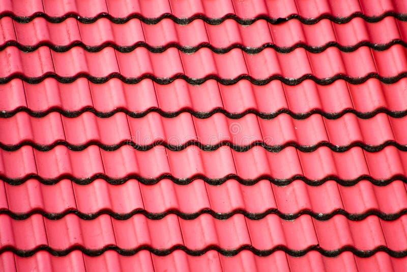 La textura del tejado de teja roja imagenes de archivo