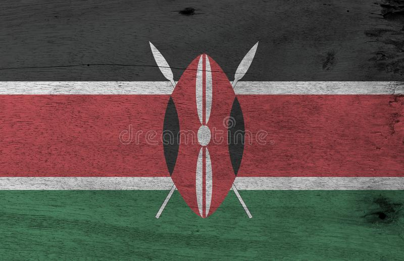 La textura Kenyan de la bandera del Grunge, el rojo blanco negro y el verde con dos cruzaron las lanzas blancas detrás de un rojo ilustración del vector