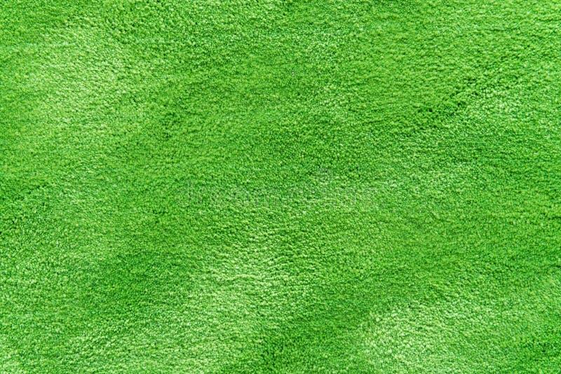 La textura natural de la hierba modeló el fondo en césped del campo de golf de la visión superior foto de archivo