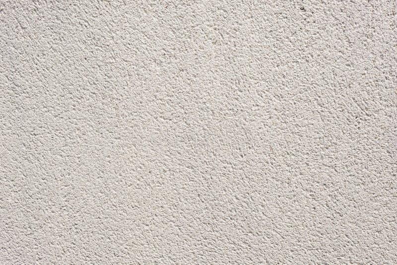 La textura real gris clara del fondo del muro de cemento, pared del cemento, textura del yeso, vacia para los diseñadores imágenes de archivo libres de regalías