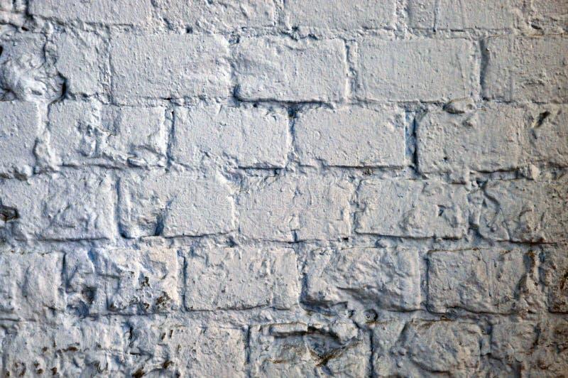 La textura resistida extracto manch? el estuco viejo gris claro y envejeci? el fondo blanco de la pared de ladrillo de la pintura fotografía de archivo libre de regalías