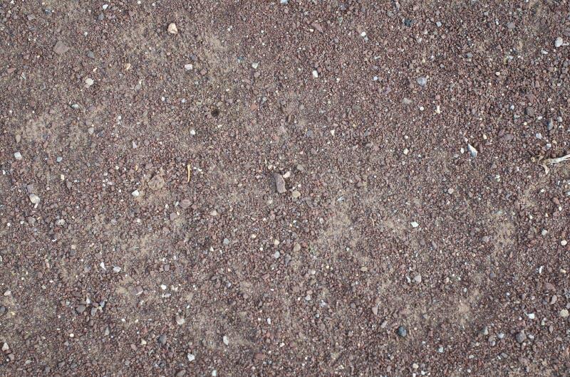 La textura roja de la suciedad en la tierra fotografía de archivo