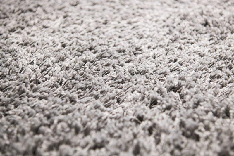 La texture blanche de fond de tapis, se ferment, texture grise de textile, fond pelucheux de couverture, texture de tissu de lain photos stock