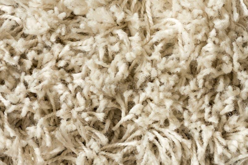 La texture blanche et beige de tapis - fermez-vous vers le haut de la vue photographie stock