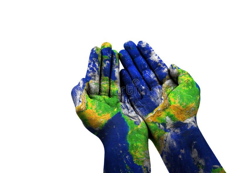 La texture bleue de la terre sur une main du ` s de femme photos libres de droits
