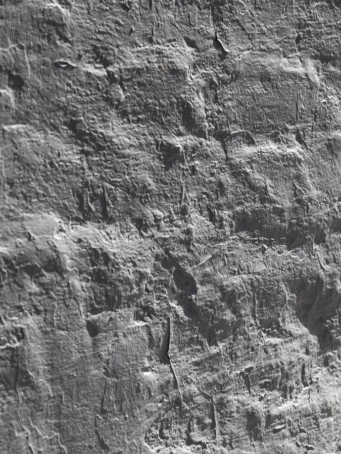 La texture d'un backgroun gris moyen de facettes de marbre de mur avec des ombres et du jeu léger pour la conception image libre de droits