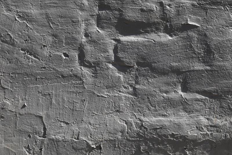 La texture d'un marbre de mur facette le backgroun gris moyen avec le jeu d'ombres pour la conception photo stock