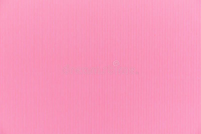 La texture de contexte du carton de papier rose avec la verticale rident image libre de droits