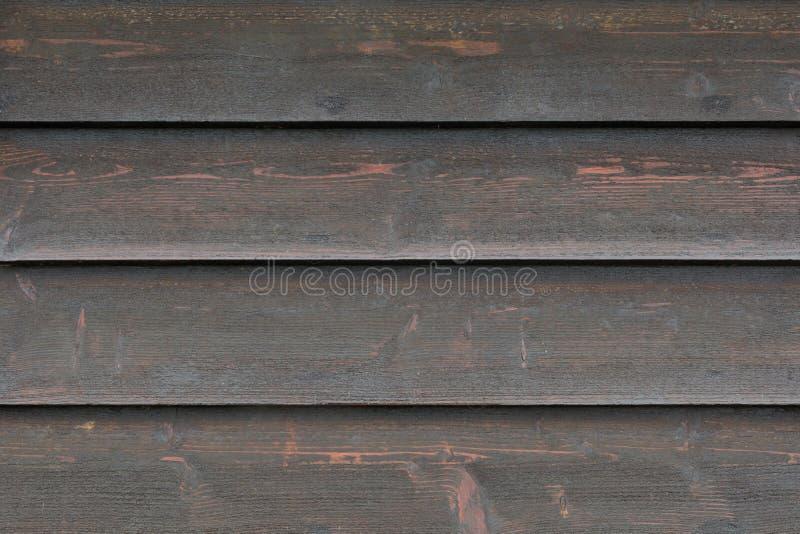 La texture de fond des conseils en bois noirs fanés, se ferment  photographie stock libre de droits