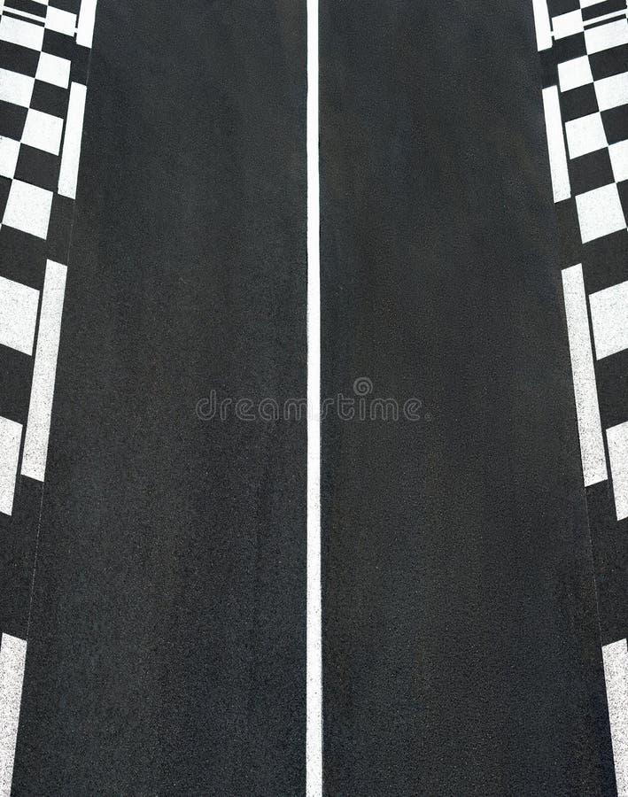 La texture de l'asphalte de course et la restriction Grand prix d'échecs font le tour images stock