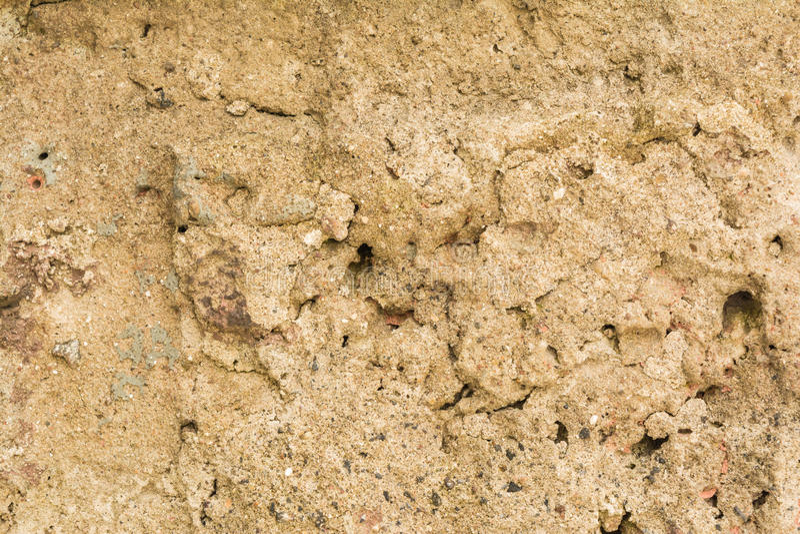 La texture de la surface du vieux mur du bâtiment, là sont des fractures, des fissures, des divorces de couleur et des gisements  image libre de droits