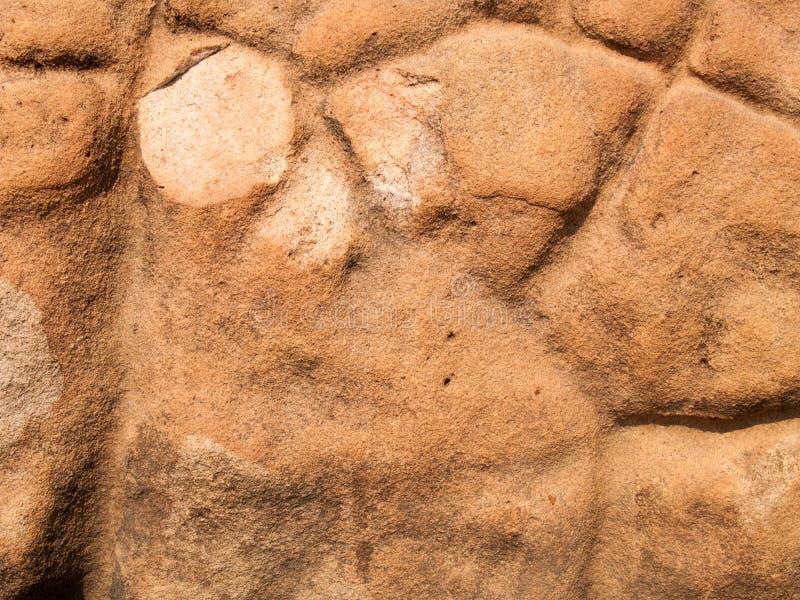 La texture de la pierre utilisée pour les fonds d'image, surface de couleur brune en pierre image libre de droits