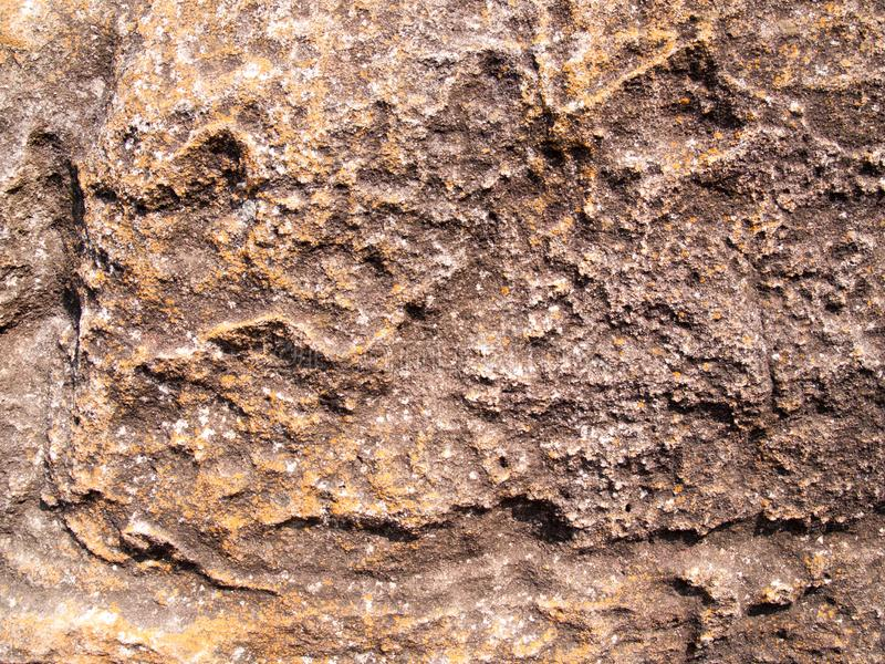 La texture de la pierre utilisée pour les fonds d'image, surface de couleur brune en pierre images libres de droits