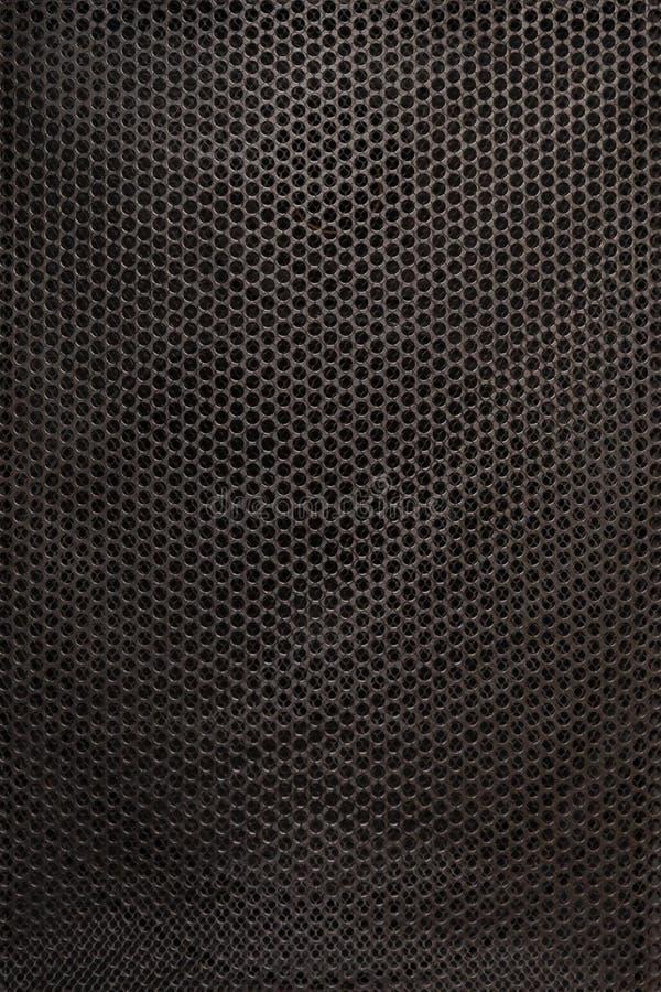 La texture des haut-parleurs audio de grille protectrice Vue étroite Filet de sécurité noir images libres de droits