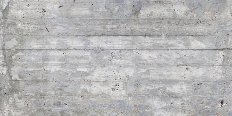 La texture du coffrage en bois a embouti sur un mur en béton cru images stock